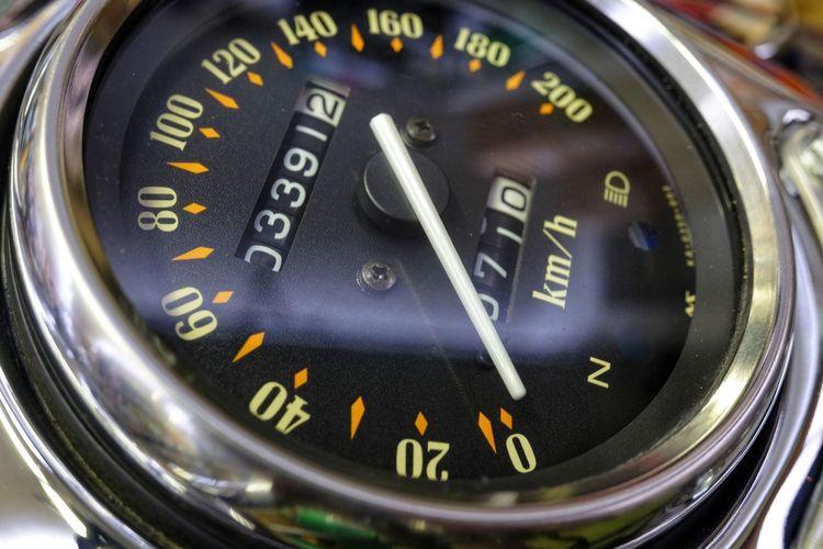 Black motorcycle speedometer