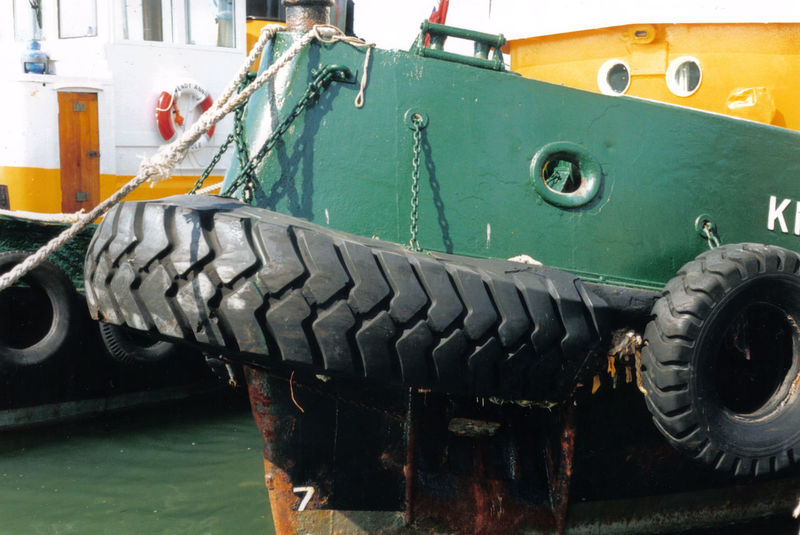 Boat Green And Yellow  Harbour Industry Machinery Metal Metallic Mooring Old Tyre Old Tyres Rusty Working Boat