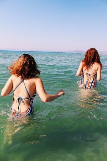 Together we are Water Beauty In Nature Two People Sea Beach Bikini Summer Lifestyles Outdoors Vacations The Week On EyeEm The Week On EyeEm Editor's Picks Fresh On Market 2017 The Great Outdoors - 2018 EyeEm Awards