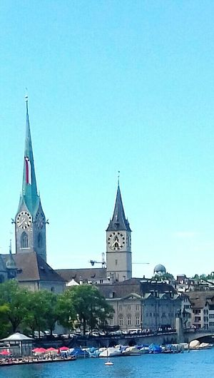 Zurich Religion Architecture Business Finance And Industry Place Of Worship Clock Tower Outdoors History No People Urban Skyline Clear Sky One Man Only Looking At Camera Freshness EyeEm EyeEm The Best Shots The Week On Eyem Exceptional Photographs Piękno Jest Wszędzie Archipelago Reflection Popular Photo Excellent Shot Taking Photos The Week Of Eyeem Adults Only