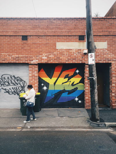 Yes Architecture Building Exterior Built Structure City Creativity Equality Full Length Graffiti Lgbt Loveislove Melbourne Multi Colored Mural One Person Rainbow Street Street Art Street Photography Streetart Streetphotography Wall