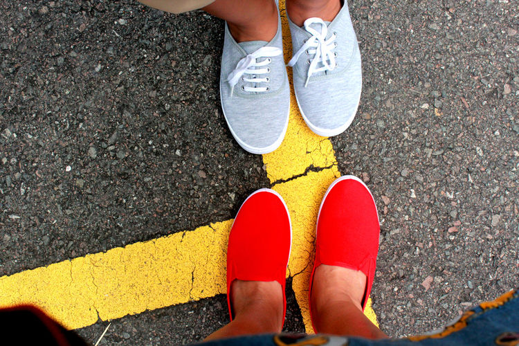 Casual Clothing Footwear High Angle View Human Foot Lifestyles Low Section Outdoors Person Red Road Road Marking Shoe Standing Street