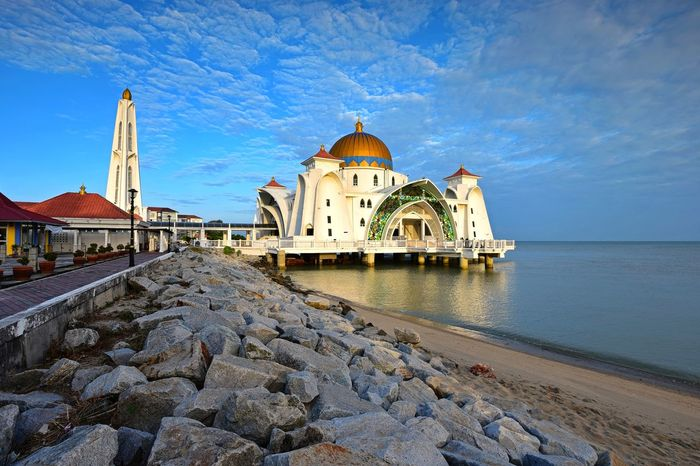 Malacca straits mosque on blue sky background Mosque Architecture Outdoor Landscape Beauty Travel Skyline Travel Destinations Nature Getty Images EyeEm Selects EyeEm Best Shots Malaysia Water Dome Place Of Worship Religion Blue History Sky Architecture Building Exterior Built Structure Shore Rushing Horizon Over Water Seascape Beach Ocean Sea