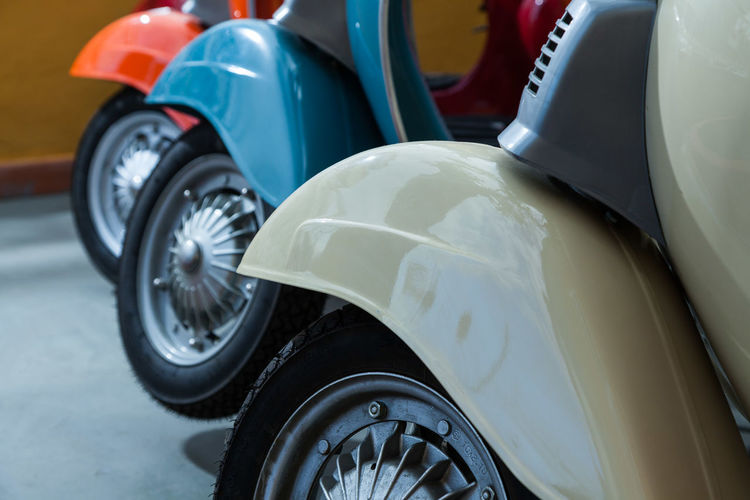 Close-up of scooters parked at shop