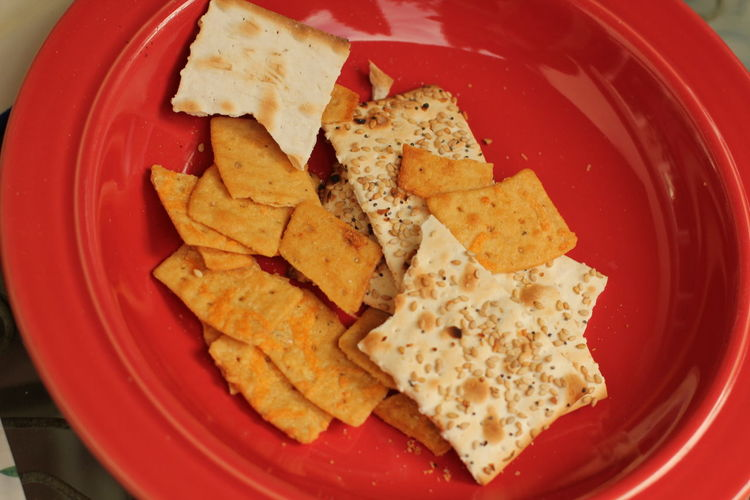 bowl of crackers at party Angle Appetizers Bowl Breakfast Cheese Crackers Close-up Food Freshness Indulgence Meal No People Party Party Foods Ready-to-eat Red Selective Focus Served Serving Size Snack Still Life Temptation Tilt Wholegrain