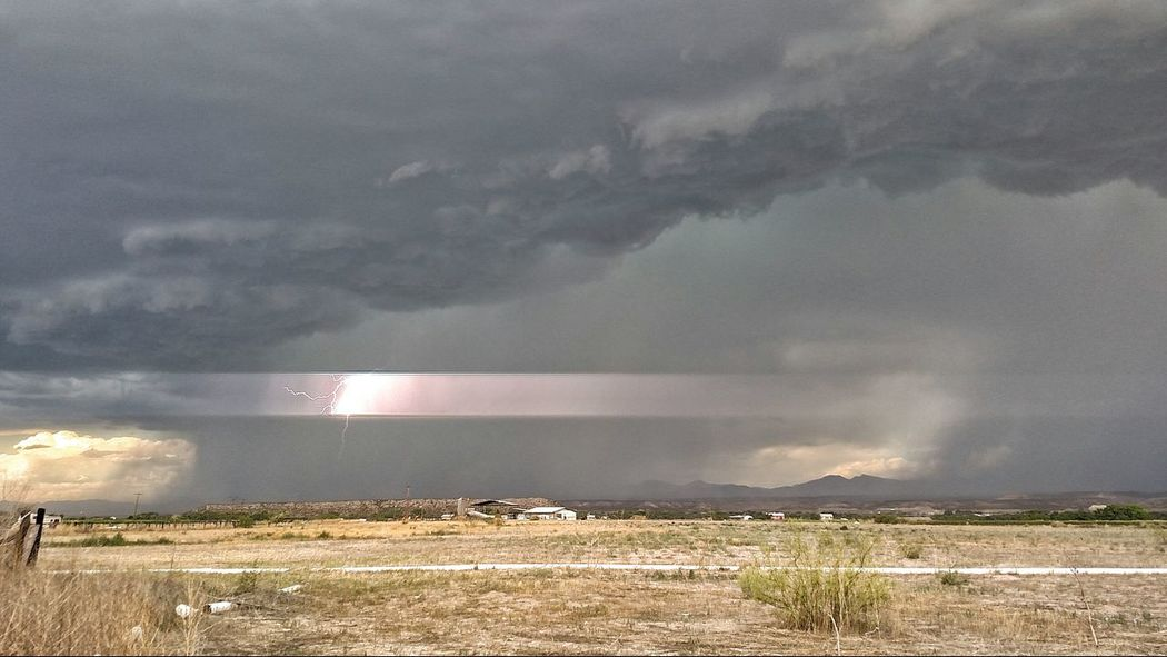 This photo is fantastic. The lightening literally split the sky. Summer Rainstorm Monsoonseason Lighteningstrike Landscapes Duncan, Arizona, United States My Year My View Lost In The Landscape