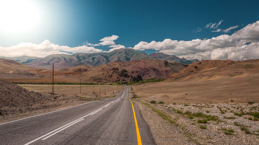 Arid Climate Beauty In Nature Cloud - Sky Diminishing Perspective Direction Dividing Line Double Yellow Line Landscape Long Marking Mountain Mountain Range Nature No People Non-urban Scene Road Road Marking Scenics - Nature Sign Sky Symbol The Way Forward Tranquil Scene Tranquility Transportation EyeEmNewHere