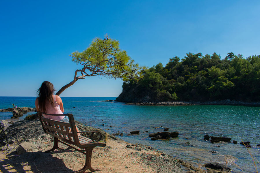 Phaselis Antalya Turkey Girl Beauty In Nature View#Capri♡#Italy And Fun Bench Water Sitting One Person Real People Tree Sky Plant Leisure Activity Nature Rear View Women Sea Scenics - Nature Lifestyles Adult Blue Day Young Adult Outdoors Hair Hairstyle