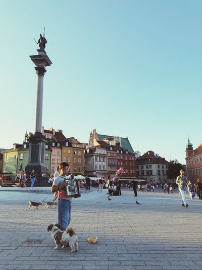 Old Town Warsaw Poland Street Musician Dogs Kid Architecture Sky Built Structure Building Exterior Real People Clear Sky Large Group Of People City Travel Destinations Crowd Tourism Travel Town Square Sculpture