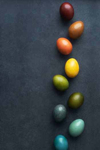 Close-up of multi colored candies against black background