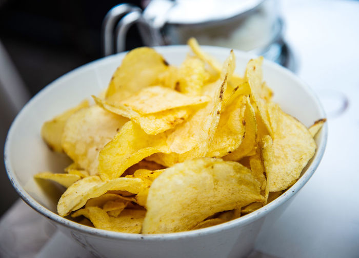 Food And Drink Bowl Close-up Fast Food Fast Food French Fries Focus On Foreground Food Food And Drink French Fries Freshness Fried Indoors  Nacho Chip No People Potato Potato Chip Prepared Potato Ready-to-eat Serving Size Snack Still Life Temptation Unhealthy Eating Yellow