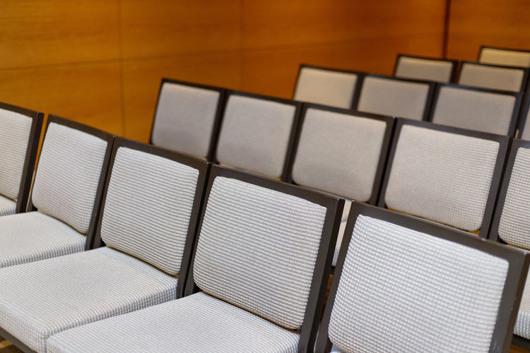 Rows of new chairs in the conference hall Indoors  No People High Angle View Close-up Furniture Seat Pattern White Color Still Life Shape Geometric Shape Table Design Chair Empty Focus On Foreground Arrangement Square Shape Order Sofa Rows Halloween