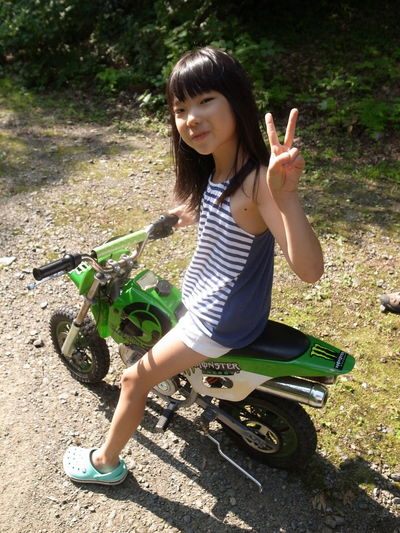 My douter on the motercycle Kids Bike Happiness Land Vehicle Littele Girl Nature One Person Outdoors Riding