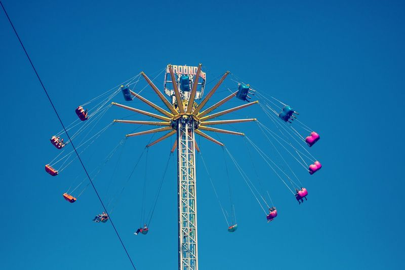 Arts Culture And Entertainment Blue Clear Sky Crazy Dizziness Enjoyment Fear Fearless Fun Funny High Leisure Activity Low Angle View Multi Colored Outdoors People Sky Turn