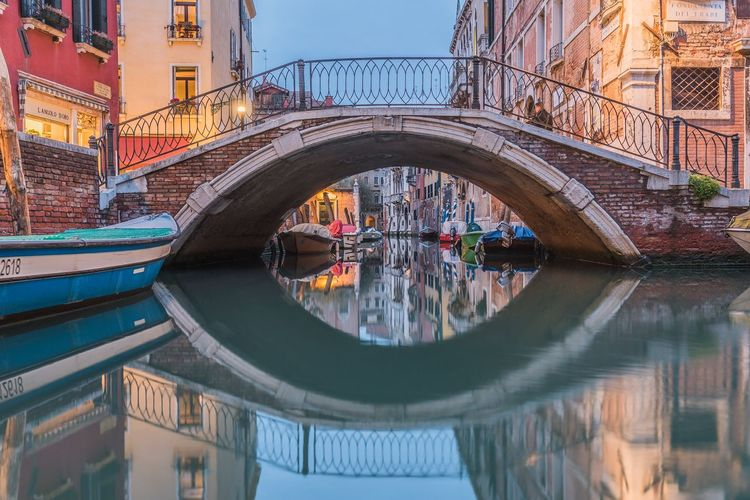 Reflection of bridge in canal