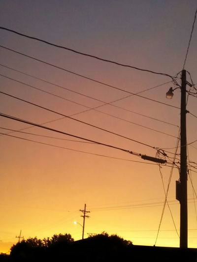 Beauty In Nature Cable Connection Electricity  Landscape Low Angle View Nature No People Orange Color Outdoors Pole Power Cable Power Line  Power Supply Scenics Sky Sunset Sunset_collection Tranquil Scene Tranquil Sky Tranquility