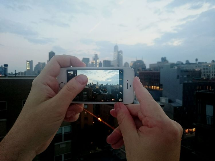 Intra Taking Photos Skyline IPhone Technology