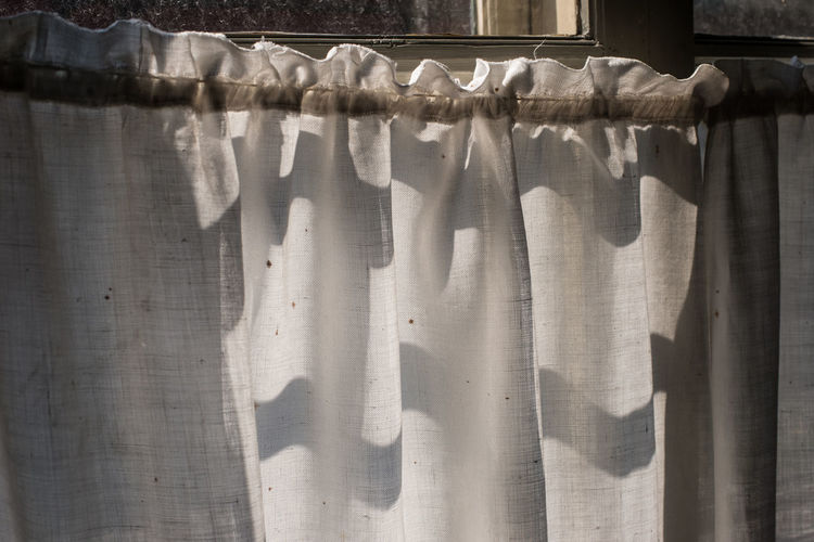 Close-up of curtain hanging on window