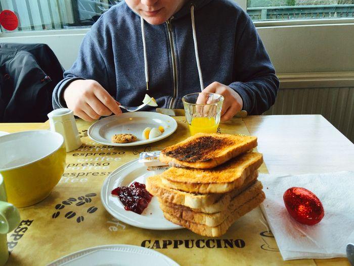 Midsection of boy having breakfast