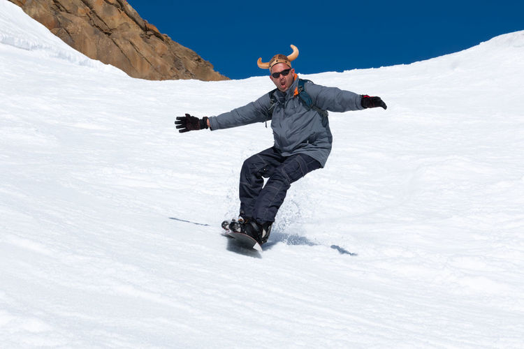 Full length of man on snowcapped mountains during winter