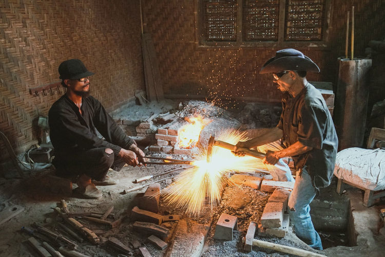 The blacksmith Keris Blacksmith  Fire Traditional Yogyakarta INDONESIA Sitting Warm Clothing Togetherness Teamwork Performance Film Industry Old-fashioned Arts Culture And Entertainment Recording Studio Coworker A New Beginning This Is Strength
