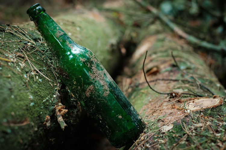 Close-up of green bottle