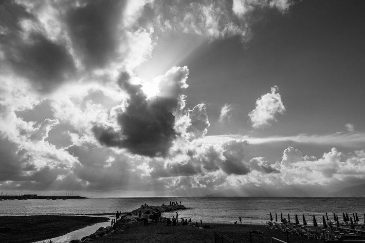 Battle for the light Sky Cloud - Sky Water Sea Horizon Horizon Over Water Beach Beauty In Nature Nature Incidental People Non-urban Scene Outdoors Scenics - Nature Ray Rays Of Light Rays Liguria Liguria,Italy Sestri Levante Blackandwhite Black And White Black & White