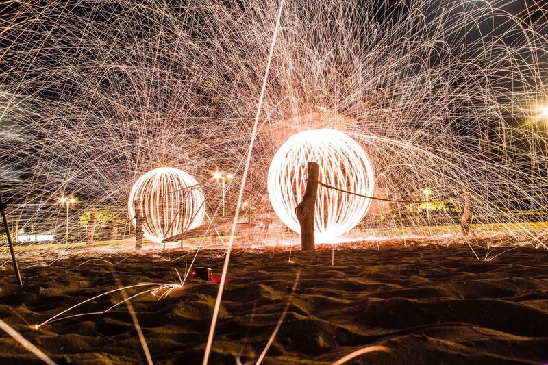 Wire wools on sandy field at night