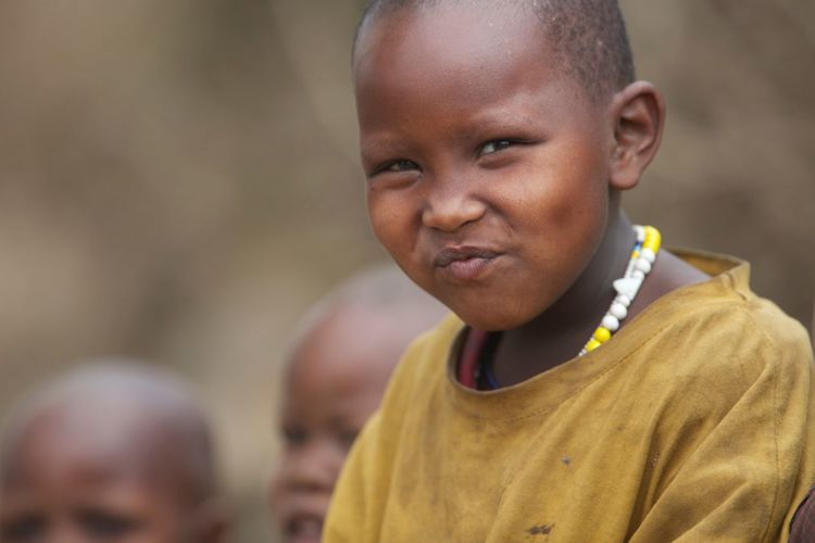 What Does Peace Look Like To You? A smiling innocent child People Peace Masai Tribe