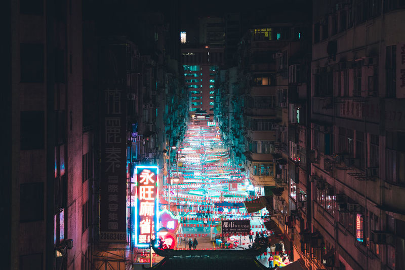 Temple Street Markets, HK. @itchban / itchban.com Hong Kong Market Architecture Building Building Exterior Built Structure Celebration City City Life Decoration Glowing Illuminated Light Lighting Equipment Motion Neon Night Nightlife No People Outdoors Residential District Street Temple Street Market The Architect - 2018 EyeEm Awards
