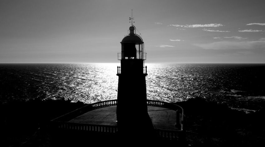 Dark Lighthouse Architecture Beauty In Nature Building Exterior Built Structure Day Direction Guidance Horizon Over Water Lighthouse Lighthouse_captures Lighthouse_lovers Nature No People Outdoors Scenics Sea Shadows Sky Summer Tranquil Scene Tranquility Water