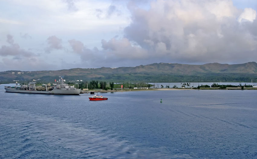 American naval base on Guam Island - South Pacific South Pacific Island US Navy Cloud - Sky Day Guam Mode Of Transport Mountain Nature Nautical Vessel Naval Base No People Outdoors Sailing Scenics Sea Sky Tranquil Scene Tranquility Transportation Water Waterfront Premium Collection