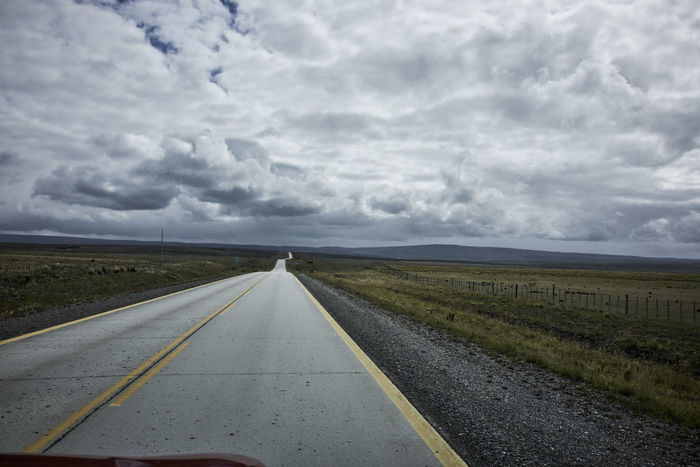 Rural Road and Overcast Sky in Patagonia Chile Cloudy Road Travel Traveling Beauty In Nature Diminishing Perspective Grassland No People Overcast Patagonia Rurual Scene Sky South America vanishing point Vehicle Shot