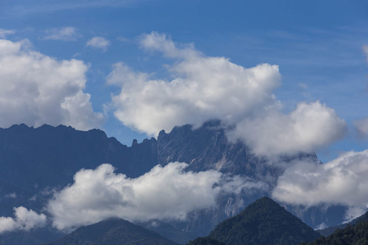 Clouds formation over peak of Mt. Kinabalu. Cloud - Sky Mountain Sky Beauty In Nature Scenics - Nature Mountain Range Tranquil Scene Nature Tranquility Non-urban Scene No People Environment Day Landscape Outdoors Idyllic Majestic Rock Mountain Peak Physical Geography Sabah Malaysia Mt. Kinabalu Kota Belud