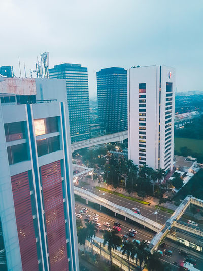 High angle view of buildings against sky in city