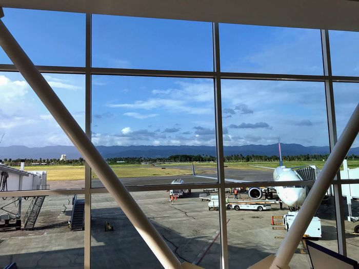 Airport window view Sky Transportation Cloud - Sky Mode Of Transportation Airport Airplane Travel Glass - Material Airport Runway Window Outdoors Land Vehicle Air Vehicle Day Airport Terminal No People Transparent Nature Built Structure Architecture