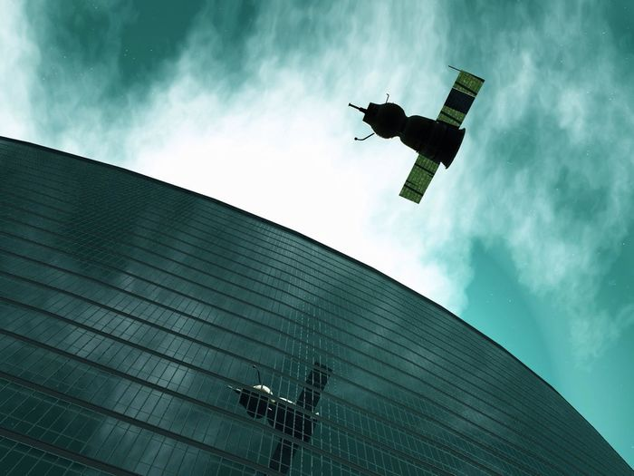 Low angle view of an aircraft and building and the sky