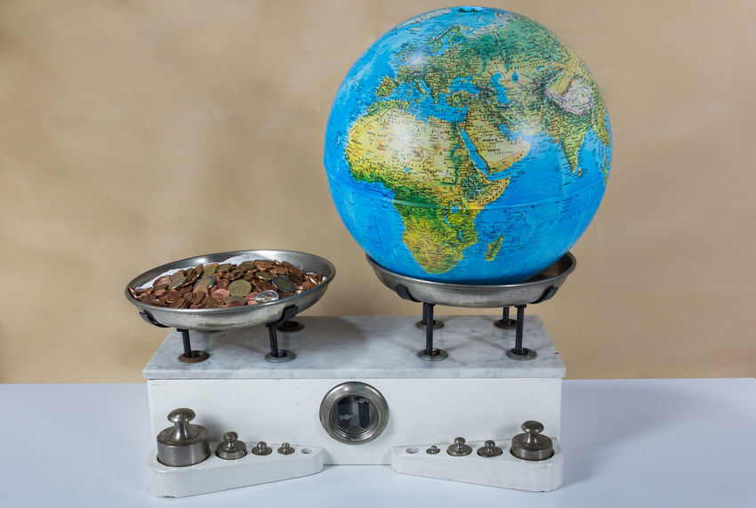 Balance with two metal plates with weights, coins and the planet earth Antique Balance Diet Gram Hearth Imbalance Kilogram Measure, Measurement Metal Money Old Planet Retro Vintage, Toy, Old Photo Weight