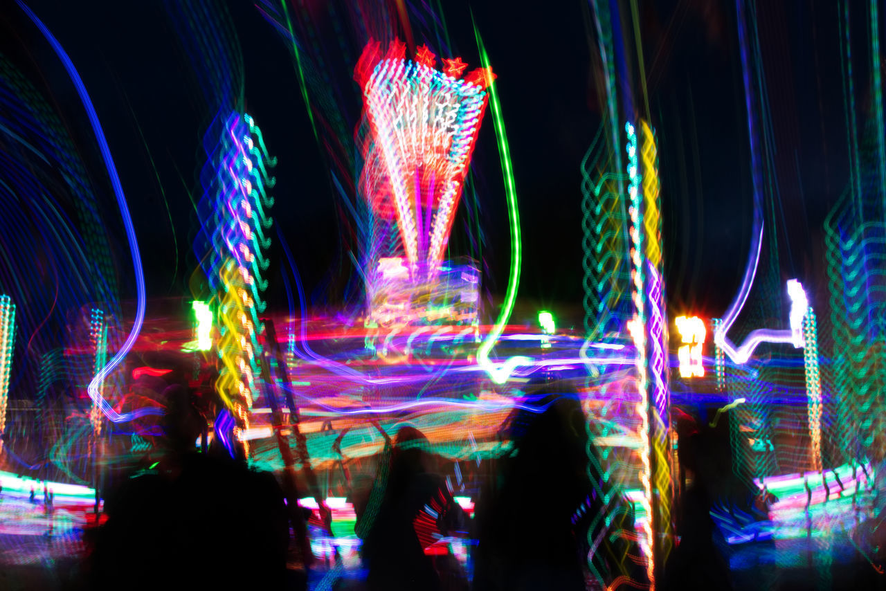 illuminated, night, multi colored, long exposure, motion, light trail, blurred motion, speed, colorful, outdoors, building exterior, no people, architecture, sky, neon, city