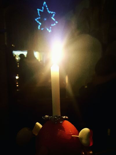 This Is Christmas day 24. Christingles Service Candle Illuminated Night Burning Light Of The World Light In Darkness Jesus