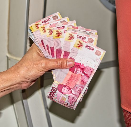 Indonesian money, over 1 Million.. Human Hand Finance Paper Currency Currency Hand One Person Business Holding Wealth Human Body Part Indoors  Close-up Adult Men Lifestyles Real People Body Part Investment Business Finance And Industry Finger Making Money Economy Indonesian Money Millionaire Rich