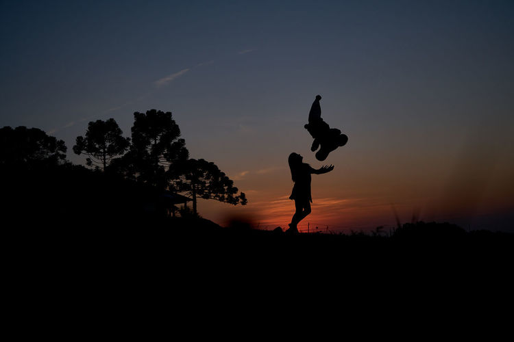 Beauty In Nature Day Energetic Flexibility Full Length Handstand  Leisure Activity Lifestyles Men Nature Outdoors People Real People Silhouette Skill  Sky Sunset Togetherness