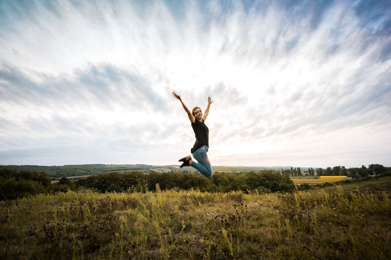 Sky Cloud - Sky One Person Limb Land Grass Field Full Length Jumping Freedom Landscape Environment Nature Leisure Activity Scenics - Nature Tranquility Outdoors Body Part Positive Emotion Excitement Happiness Happy Girl Fit Fitness