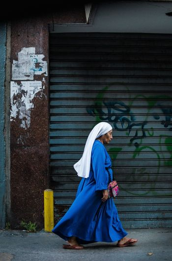 City is outhere waiting... Full Length One Person Women Clothing Architecture Real People Traditional Clothing Hijab Adult Side View Lifestyles Wall - Building Feature Built Structure Females Building Exterior Blue Religion Outdoors Profile View Social Issues Beautiful Woman Street Photography EyeEm Best Shots EyeEm Selects The Art Of Street Photography The Street Photographer - 2019 EyeEm Awards