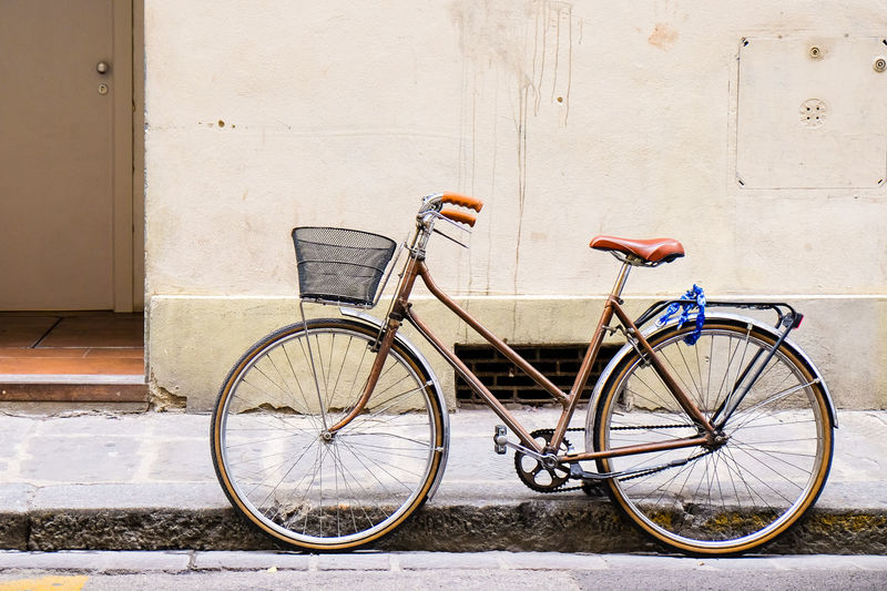 Old retro bicycle standing on a street in Florence, Italy by a wall Cycle Architecture Basket Bicycle Bicycle Basket Bike Building Exterior Built Structure City Day Footpath Land Vehicle Leaning Mode Of Transportation No People Outdoors Stationary Street Transportation Urban Wall Wall - Building Feature Wheel