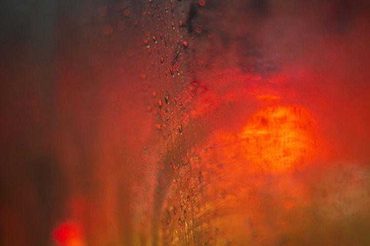 Orange Color Red No People Selective Focus Full Frame Close-up Nature Backgrounds Water Outdoors Heat - Temperature Burning Textured  Wet Sunset Glass - Material Fire Pattern Transparent