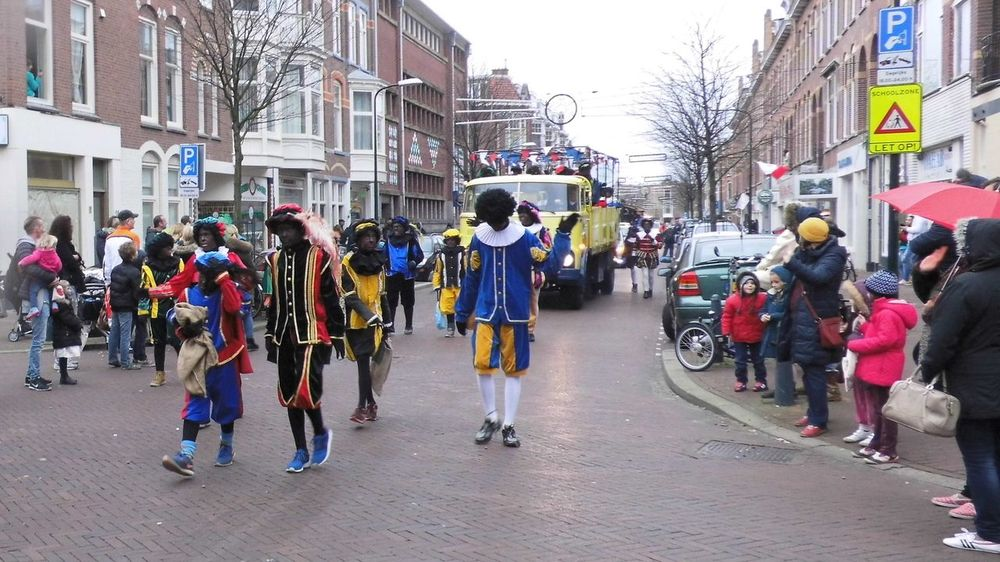 City Life Culture Large Group Of People Lifestyles Men Mode Of Transport Real People Road Street Streetphotography Traditional Walking Women Zwarte Piet