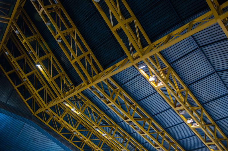 Architectural Design Architecture Blue Built Structure Hall Hockey Hall Illuminated Indoors  Lines Lines And Shapes Low Angle View Metal Modern No People Pattern Rectangles Roof Shapes Squares Yellow
