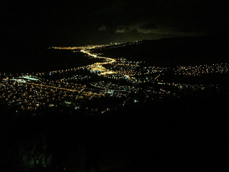 """""""The lights from up here are like the burning flames. That's scattered to show us the way and guide us through."""" Scenery Kokohead Paradise Hawaii Hawaiinei Hikers Citylights Iphonephotography"""