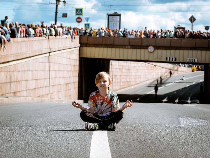 Boy sitting on street
